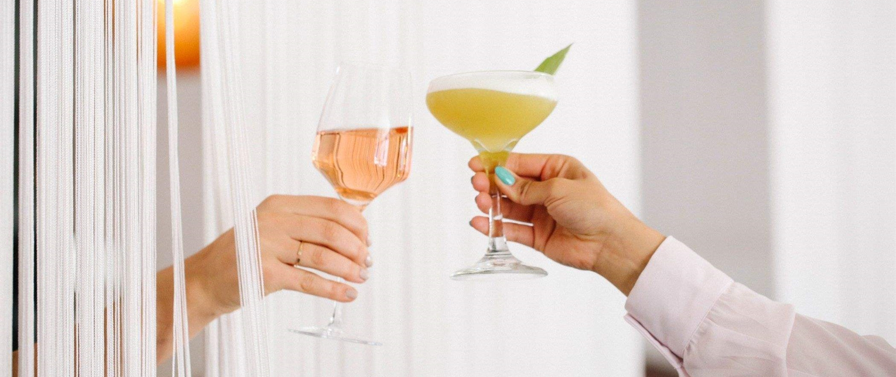 cheers with two cocktails